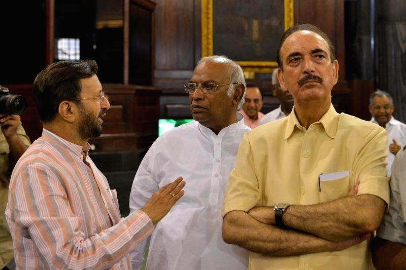 Union Minister Prakash Javadekar, Congress parliamentary party in Lok Sabha Mallikarjun Kharge and  er of Opposition in Rajya Sabha Ghulam Nabi Azad during a programme organised to pay ... - Prakash Javadekar