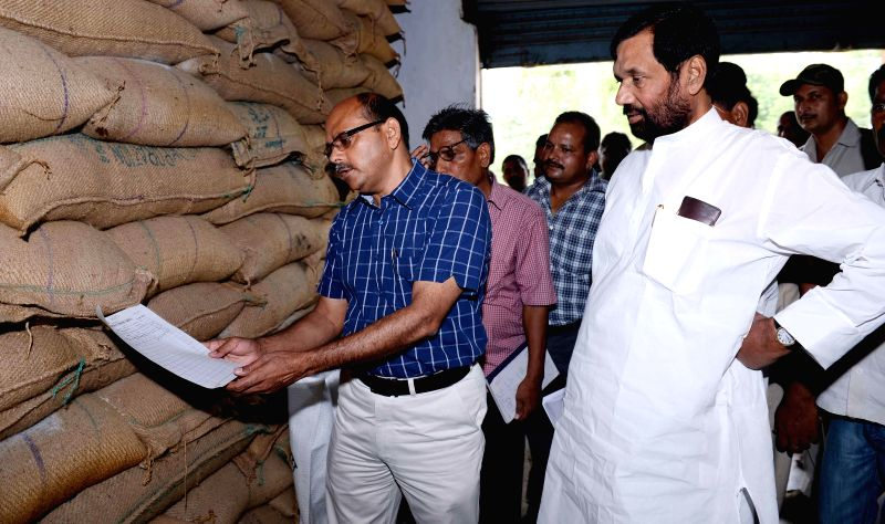 Union Minister Ram Vilas Paswan during a tour of FCI godown in Patna on June 16, 2014.