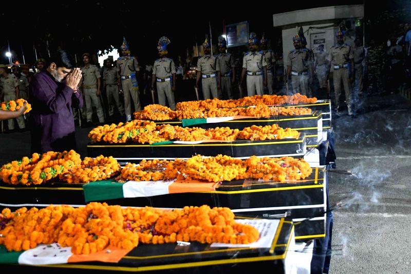 Union Minister Ramkripal Yadav pays tribute to slain CRPF personnel who were martyred in an ambush in Chhattisgarh's Sukma; in Patna on April 25, 2017. - Ramkripal Yadav