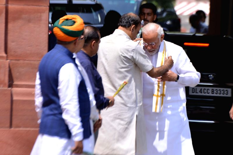 Union Ministers Ananth Kumar, Jitendra Singh, Vijay Goel and Arjun Ram Meghwal welcome Prime Minister Narendra Modi on his arrival to attend the Monsoon Session of Parliament, in New ... - Narendra Modi, Ministers Ananth Kumar, Jitendra Singh, Vijay Goel and Arjun Ram Meghwal