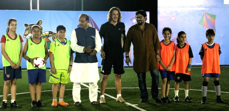 Union Ministers Babul Supriyo and Vijay Goel with retired Spanish footballer Carles Puyol during a programme organised to kick off U-17 FIFA World Cup ticketing programme in New Delhi, on ... - Babul Supriyo and Vijay Goel