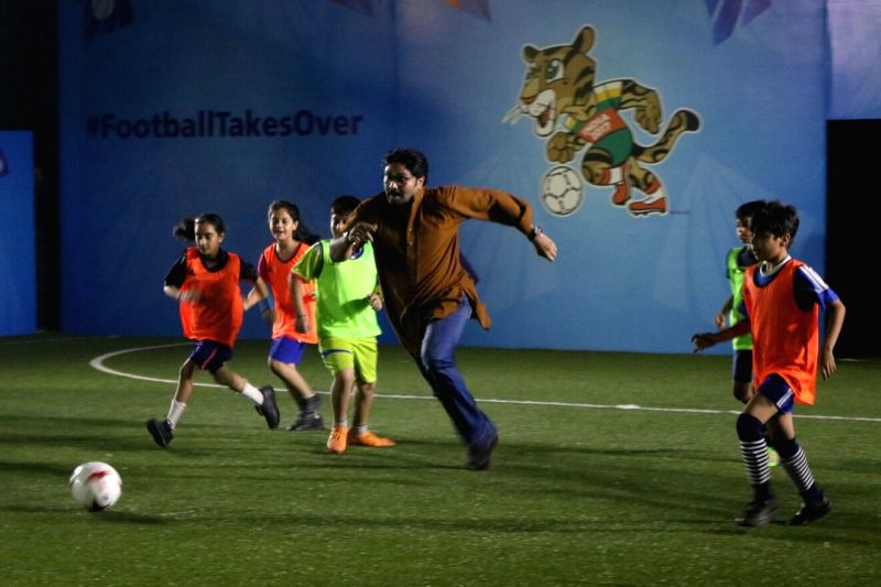Union Ministers Babul Supriyo plays football with children during a programme organised to kick off U-17 FIFA World Cup ticketing programme in New Delhi, on May 15, 2017. - Babul Supriyo