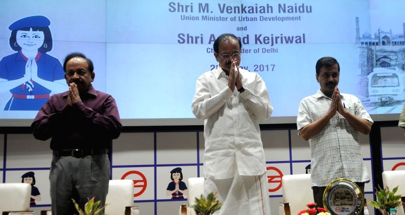 "Union Ministers Dr Harsh Vardhan and Venkaiah Naidu with Delhi Chief Minister Arvind Kejriwal during a programme organised to inaugurate Delhi Metro's ""Heritage Line"" in New ... - Arvind Kejriwal and Venkaiah Naidu"