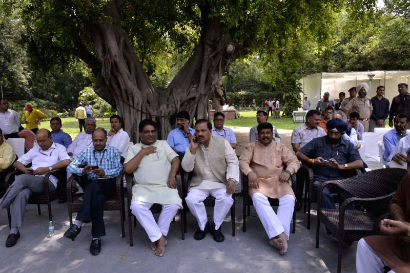 Union Ministers Mahesh Sharma and Dharmendra Pradhan at the residence of Environment Minister Anil Madhav Dave, who died at his official residence following cardiac arrest, in New Delhi on ... - Anil Madhav Dave, Ministers Mahesh Sharma and Dharmendra Pradhan
