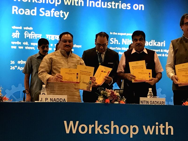 Union Ministers Nitin Gadkari and J.P. Nadda release the publication at the inauguration of the workshop on industries issues on Road Safety, in New Delhi on April 26, 2018. - Nitin Gadkari and J.