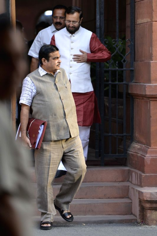 Union Ministers Nitin Gadkari, Prakash Javadekar and D. V. Sadananda Gowda come out after a Cabinet Meeting at South Block in New Delhi on May 24, 2017. - Nitin Gadkari, Prakash Javadekar and D. V. Sadananda Gowda