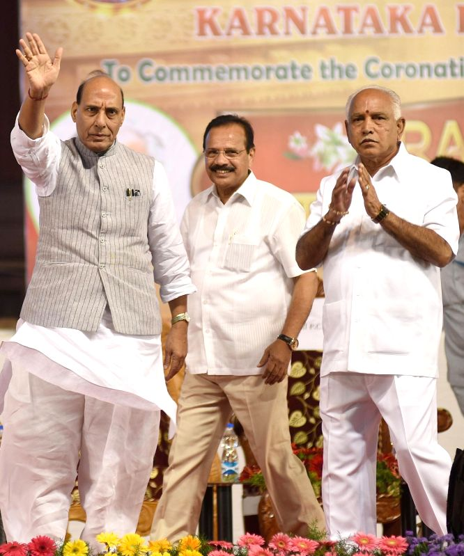 "Union Ministers Rajnath Singh and DV Sadananda Gowda, Karnataka BJP President BS Yeddiyurappa and others at the inauguration of ""Karnataka Raju Kshatriya Association"" conference ... - Ministers Rajnath Singh and D"