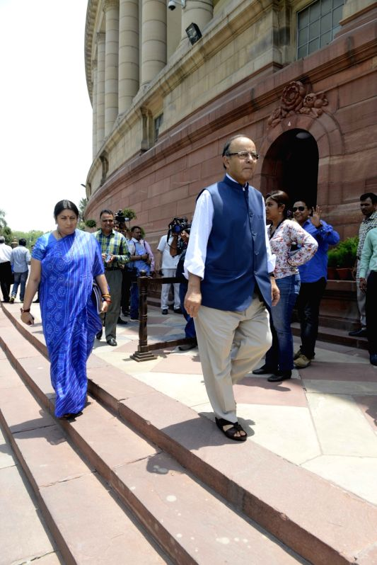 Union ministers Smriti Irani and Arun Jaitley arrives for the Cabinet meeting at the Parliament in New Delhi on May 11, 2016. - Smriti Irani and Arun Jaitley
