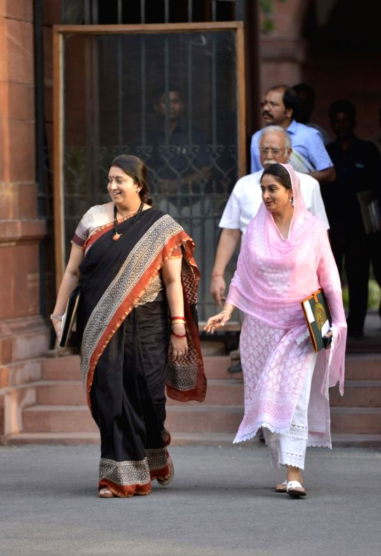 Union Ministers Smriti Irani and Harsimrat Kaur Badal come out after a Cabinet Meeting at South Block in New Delhi on May 24, 2017. - Ministers Smriti Irani and Harsimrat Kaur Badal
