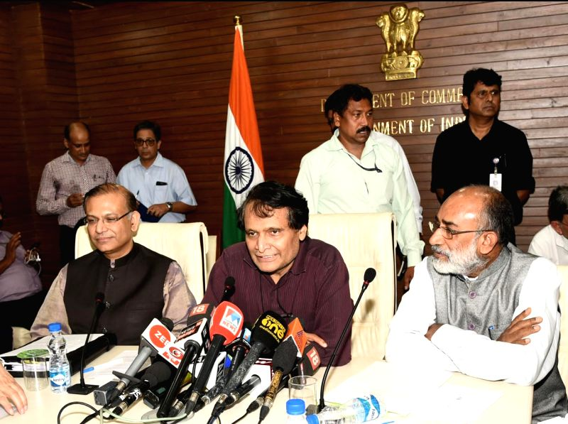 Union Ministers Suresh Prabhakar Prabhu, Alphons Kannanthanam and Jayant Sinha at a Joint Press Conference, in New Delhi, on Aug 9, 2018. - Suresh Prabhakar Prabhu, Alphons Kannanthanam and Jayant Sinha