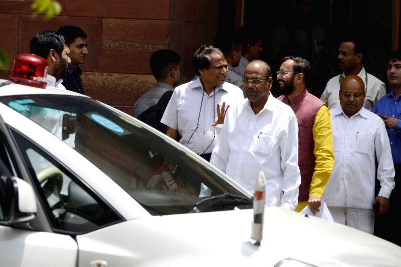 Union Ministers Suresh Prabhakar Prabhu, Prakash Javadekar, Thawar Chand Gehlot, come out after a cabinet meeting at South Block in New Delhi on June 1, 2016. - Suresh Prabhakar Prabhu, Prakash Javadekar and Thawar Chand Gehlot