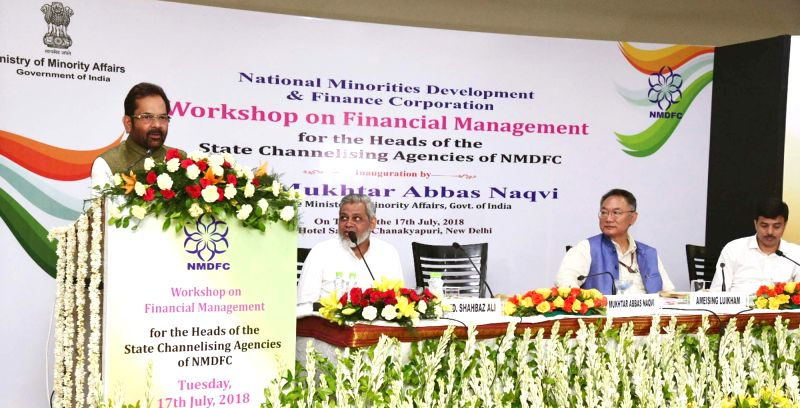 Union Minority Affairs Minister Mukhtar Abbas Naqvi addresses at the National Minorities Development and Finance Corporation (NMDFC) workshop on financial management, in New Delhi on July ... - Mukhtar Abbas Naqvi