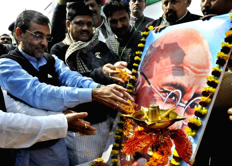 Union MoS and Rashtriya Lok Samata Party (RLSP) chief Upendra Kushwaha pays tribute to the portrait of Mahatma Gandhi on his death anniversary in Patna on Jan 30, 2018.