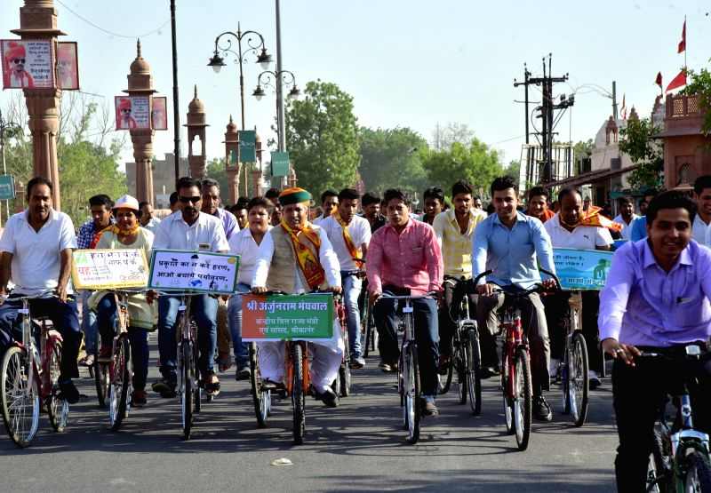 Union MoS Finance Arjun Ram Meghwal participates in a cycle rally on World Environment Day in Bikaner, on June 5, 2017.