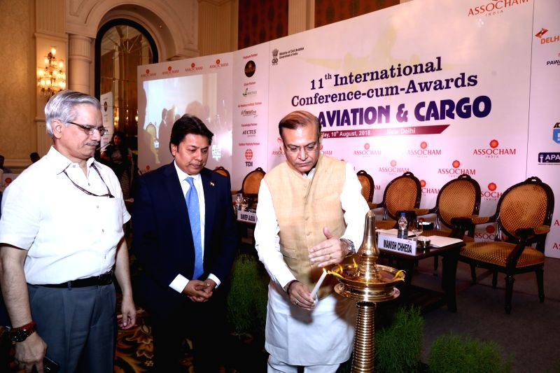 Union MoS for Civil Aviation Jayant Sinha lights the ceremonial lamp along with Ministry of Civil Aviation Secretary RN Choubey and ASSOCHAM President Sandeep Jajodia during the ASSOCHAM ... - Aviation Jayant Sinha