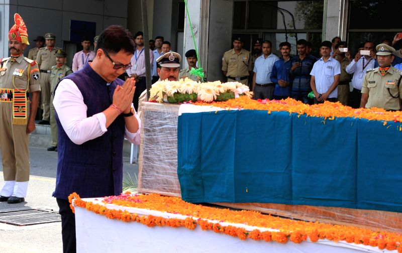 Union MoS for Home Affairs Kiren Rijiju pays tributes to the martyred BSF head constable Prem Sagar in New Delhi on May 02, 2017.