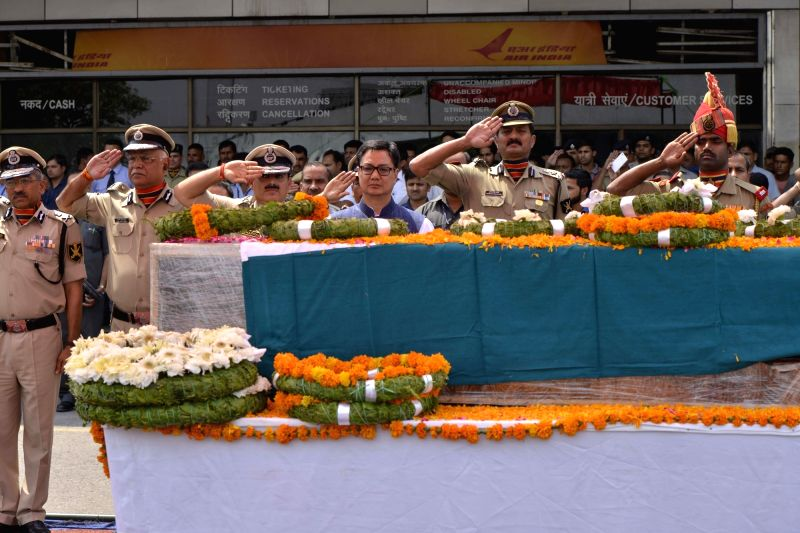 Union MoS for Home Affairs Kiren Rijiju pays tributes to the martyred BSF head constable Prem Sagar in New Delhi on May 2, 2017.