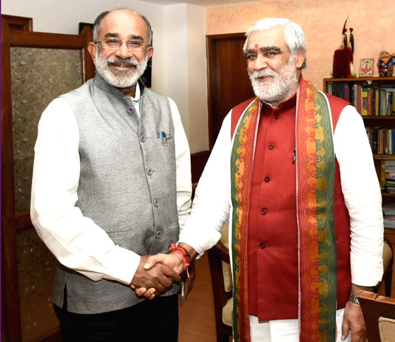 Union MoS Health and Family Welfare Ashwini Kumar Choubey meets Union MoS Tourism Alphons Kannanthanam, in New Delhi on July 25, 2018.