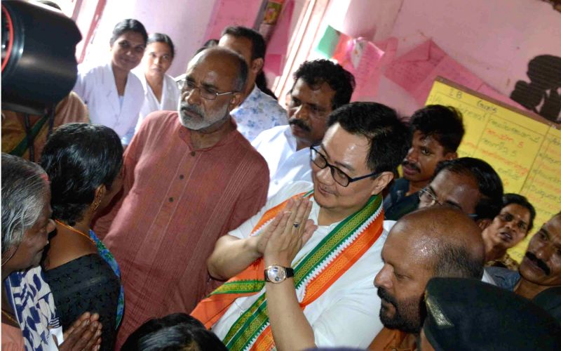 Union MoS Home Affairs Kiren Rijiju and Union MoS Tourism Alphons Kannanthanam during their visit to a flood relief camp at Aryad in Alappuzha district of Kerala on July 21, 2018.
