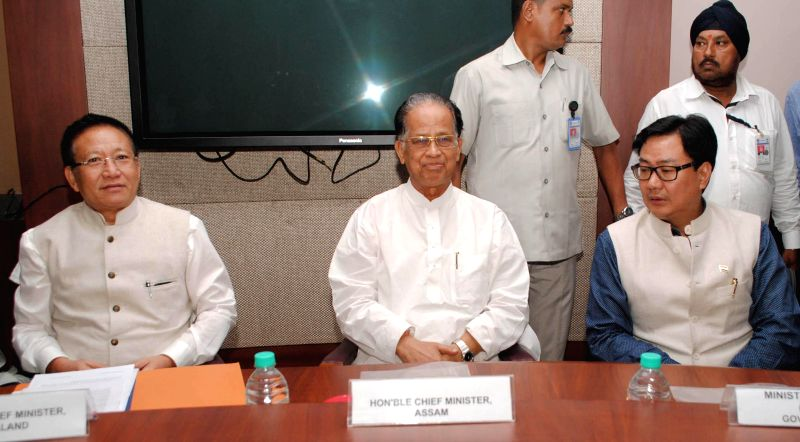 Union MoS Home Affairs Kiren Rijiju with Nagaland Chief Minister T R Zeliang and Assam Chief Minister Tarun Gogoi a tripartite meeting regarding Assam-Nagaland Border conflict in Guwahati on Aug 21, . - T R Zeliang
