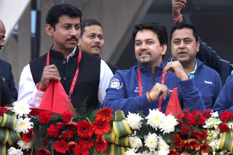 Union MoS Information and Broadcasting  Col. Rajyavardhan Singh Rathore and BJP leader Anurag Thakur during Airtel Delhi Half Marathon at Jawaharlal Nehru Stadium in New Delhi on Nov 23, 2014. - Rajyavardhan Singh Rathore