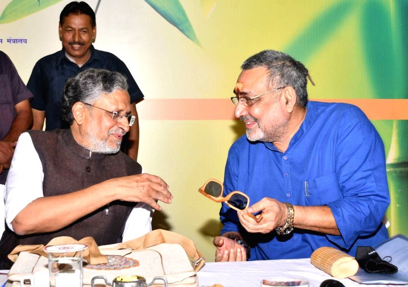 Union MoS Micro, Small and Medium Enterprises Giriraj Singh shows a spectacle frame made up of bamboo to Bihar Deputy Chief Minister Sushil Kumar Modi during Bamboo Conclave, in Patna on June ... - Sushil Kumar Modi and Enterprises Giriraj Singh