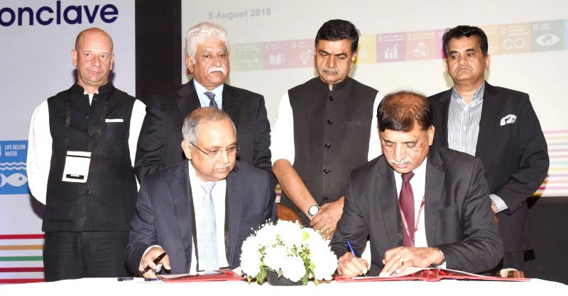 Union MoS Power and New and Renewable Energy Raj Kumar Singh and NITI Aayog CEO Amitabh Kant along with other dignitaries witness the signing of an MoU at the Government and Business ...