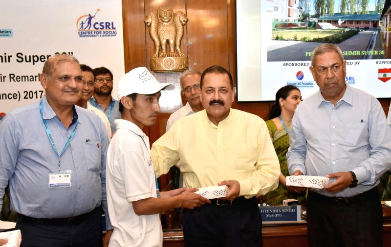 Union MoS Prime Minister's Office Jitendra Singh felicitates the students from Jammu and Kashmir (supported by 'Kashmir Super 30' Project) who have qualified for the JEE (Main & ... - Jitendra Singh