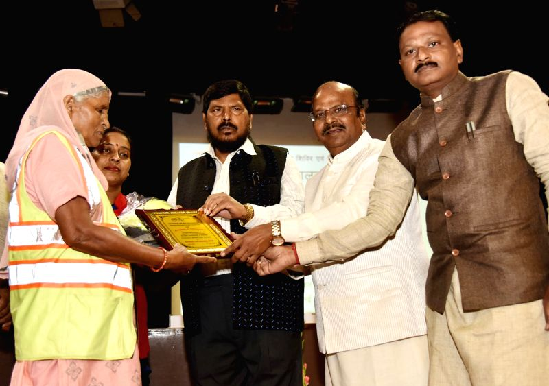 Union MoS Social Justice and Empowerment Ramdas Athawale and National Commission for Safai Karamcharis (NCSK) Chairman Manhar Valjibhai Zala distribute Safety Kits to Safai Karamcharis, at ...