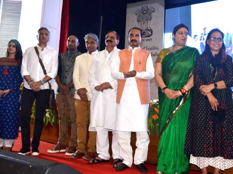 Union MoS Textiles Ajay Tamta and Union MoS Skill Development and Entrepreneurship Rajiv Pratap Rudy during a programme organised on 2nd National Handloom Day in Varanasi on Aug 7, 2016.