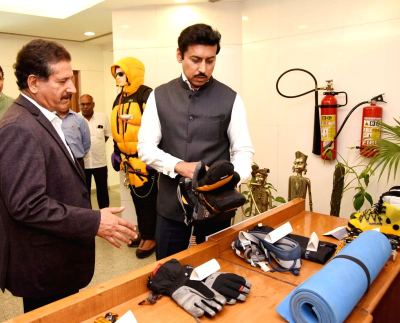 Union MoS Youth Affairs and Sports Rajyavardhan Singh Rathore visits an exhibition at the flag-off ceremony of an all-women expedition to Mt. Manirang (Himachal Pradesh), in New Delhi on ... - Rajyavardhan Singh Rathore