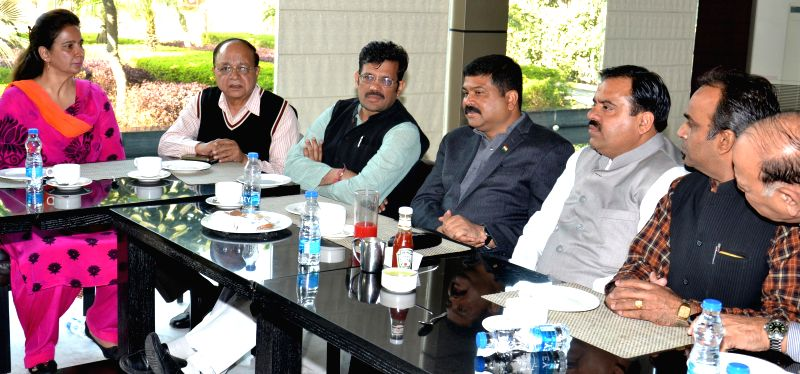 Union Petroleum and Natural Gas Minister Dharmendra Pradhan with BJP leaders during a party programme in Amritsar on Nov 18, 2014.