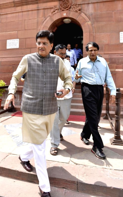Union Power Minister Piyush Goyal and Railways Minister Suresh Prabhu at Parliament on Aug 11, 2017. - Piyush Goyal and Suresh Prabhu