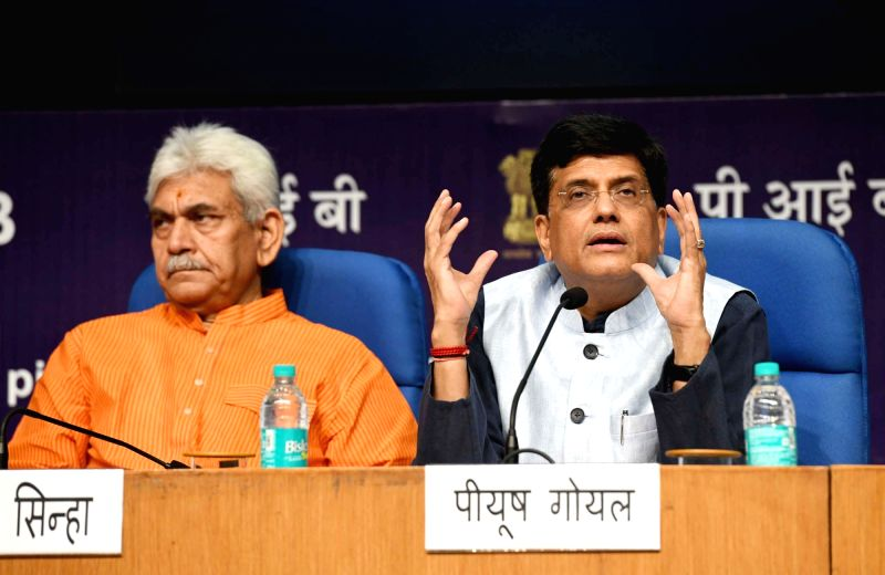 Union Railway and Coal Minister Piyush Goyal addresses a press conference on the achievements of the Ministry of Railways and Coal, during the last four years, in New Delhi, on June 11, ... - Piyush Goyal and Manoj Sinha