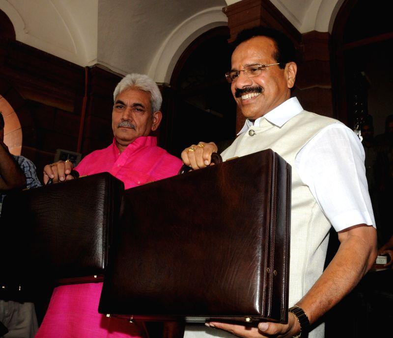 Union Railway Minister D.V. Sadananda Gowda and MoS Railway Manoj Sinha head towards Parliament to present Rail Budget 2014-15 in New Delhi on July 6, 2014. - D. and Manoj Sinha