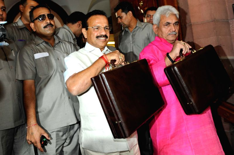 Union Railway Minister D.V. Sadananda Gowda and MoS Railway Manoj Sinha head towards the Parliament to present Rail Budget 2014-15 in New Delhi on July 6, 2014. - D. and Manoj Sinha