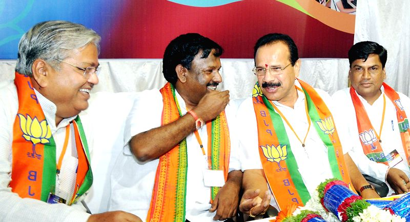 Union Railway Minister DV Sadananda Gowda with BJP leader Govind Karjol and others during a BJP meeting in Bangalore on Aug 3, 2014.