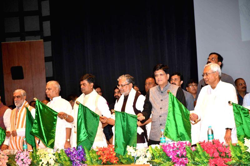 Union Railway Minister Piyush Goyal, Bihar Chief Minster Nitish Kumar, Deputy Chief Minister Sushil Kumar Modi and Union Ministers RK Singh and Ashwini Choubey flag off  the Sakri-Biraul ... - Piyush Goyal and Sushil Kumar Modi