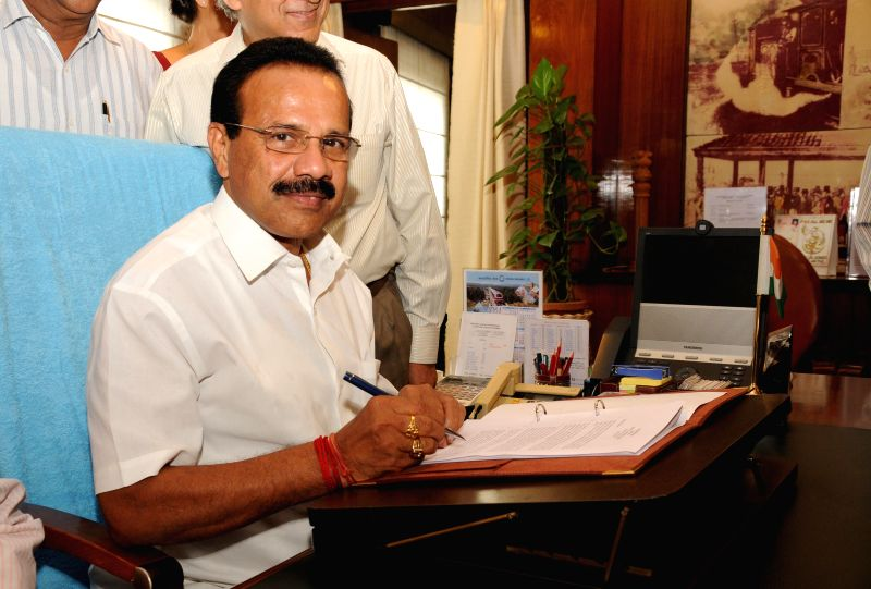 Union Railway Minister Sadanand Gowda gives final touches to Railway Budget 2014-15 in New Delhi on July 7, 2014. - Sadanand Gowda