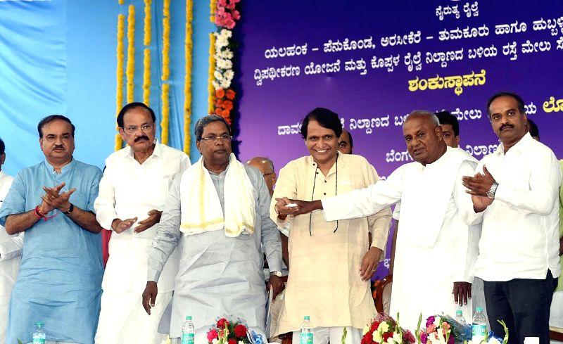 Union Railway Minister Suresh Prabhu, former prime minister H D Deve Gowda, Karnataka Chief Minister Siddaramaiah, Union Ministers M Venkaiah Naidu, Ananth Kumar during a programme ... - Suresh Prabhu, M Venkaiah Naidu and Ananth Kumar