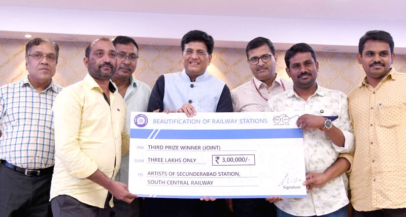 Union Railways Minister Piyush Goyal felicitates the artists who participated in Railways' station beautification initiative in New Delhi on July 12, 2018. Also seen Union MoS Railways ... - Piyush Goyal