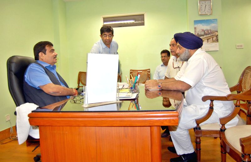 Union Road Transport, Highways and Shipping Minister Nitin Gadkari with Deputy Chief Minister Punjab Sukhbir Singh Badal in New Delhi on Aug 4, 2014. - Sukhbir Singh Badal