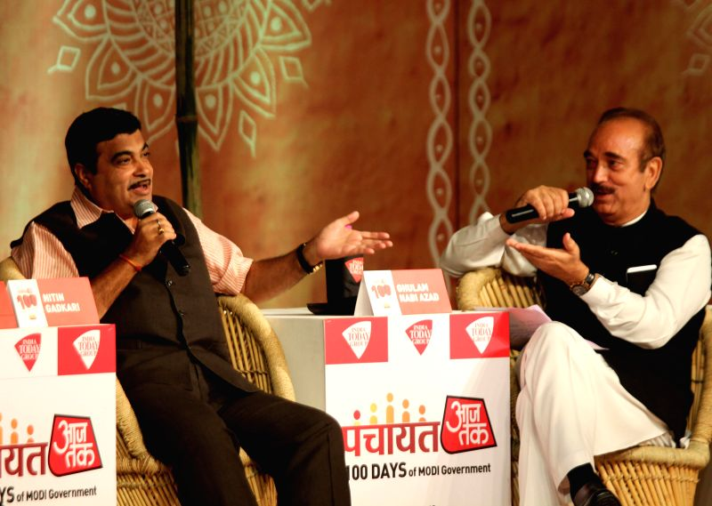 Union Road Transport, Highways and Shipping Minister Nitin Gadkari and Congress MP Ghulam Nabi Azad at Panchayat-100 Days of Modi Government organised by AAJ Tak in New Delhi on Sept 2, 2014. - Nitin Gadkari