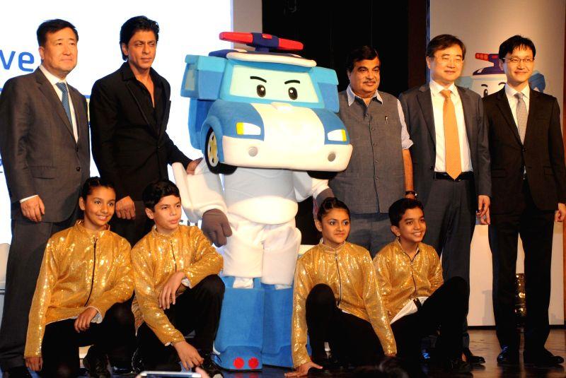 Union Road Transport, Highways and Shipping Minister Nitin Gadkari, South Korean Ambassador Cho Hyun, Hyundai MD Y K Koo and actor Shah Rukh Khan at the  launch of Hyundai`s `Safe Move - ...