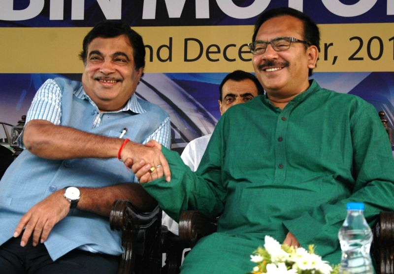 Union Road Transport, Highways and Shipping Minister Nitin Gadkari with West Bengal Minister Aroop Biswas during the concluding ceremony of BBIN Motor Rally in Kolkata, on Dec 2, 2015. - Nitin Gadkari