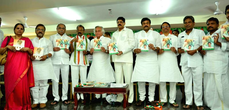 Union Rural Development Minister Jairam Ramesh with Raghuveera Reddy, Ramnarayan Reddy and Chiranjeevi during release of Congress manifesto at Indira Bhavan in Hyderabad on April 18, 2014. - Raghuveera Reddy and Ramnarayan Reddy