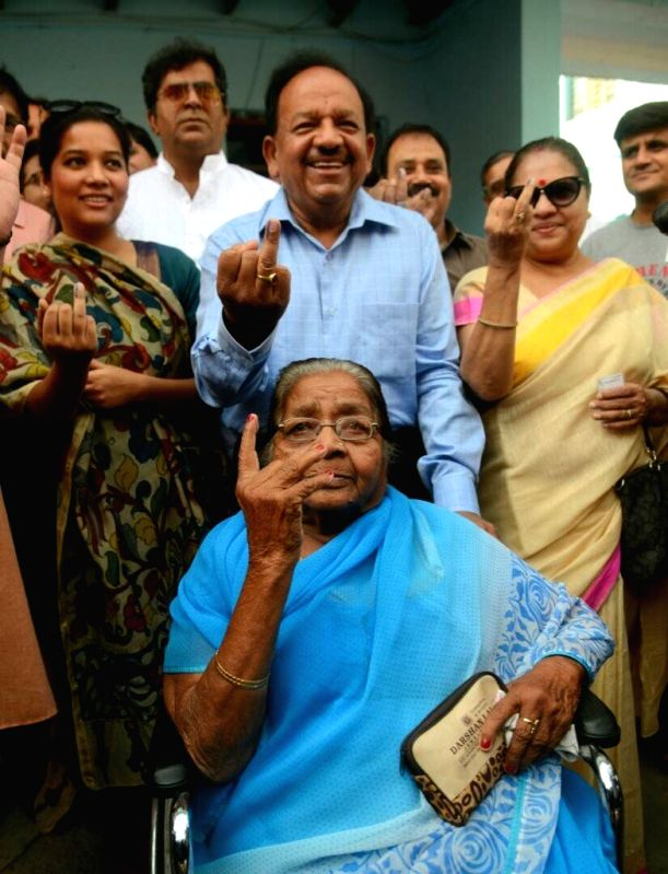Union Science and Technology Minister Harsh Vardhan shows his finger marked with phosphorus ink after casting vote during MDC elections in New Delhi on April 23, 2017. - Harsh Vardhan