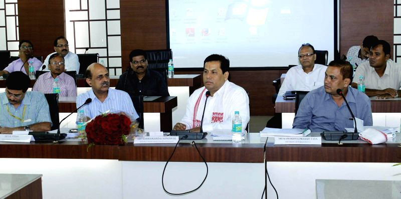 Union Sports Minister Sarbananda Sonowal during a review meeting on major road development works for Assam, in Guwahati on Sept 2, 2014. - Sarbananda Sonowal