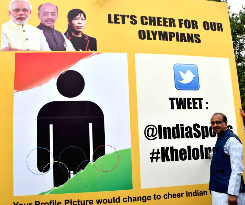 "Union Sports Minister Vijay Goel and boxer Mary Kom at the inauguration of ""Wall Of Wishes"" & ""Digital Campaign of Wishes"" for Indian Olympic Contingent in New ... - Vijay Goel and Mary Kom"