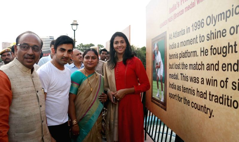 Union Sports Minister Vijay Goel with Indian cricketer Gautam Gambhir, athlete Anju Bobby George, weightlifter Karnam Malleswari at the inauguration of an exhibition ahead of Rio 2016 ... - Vijay Goel
